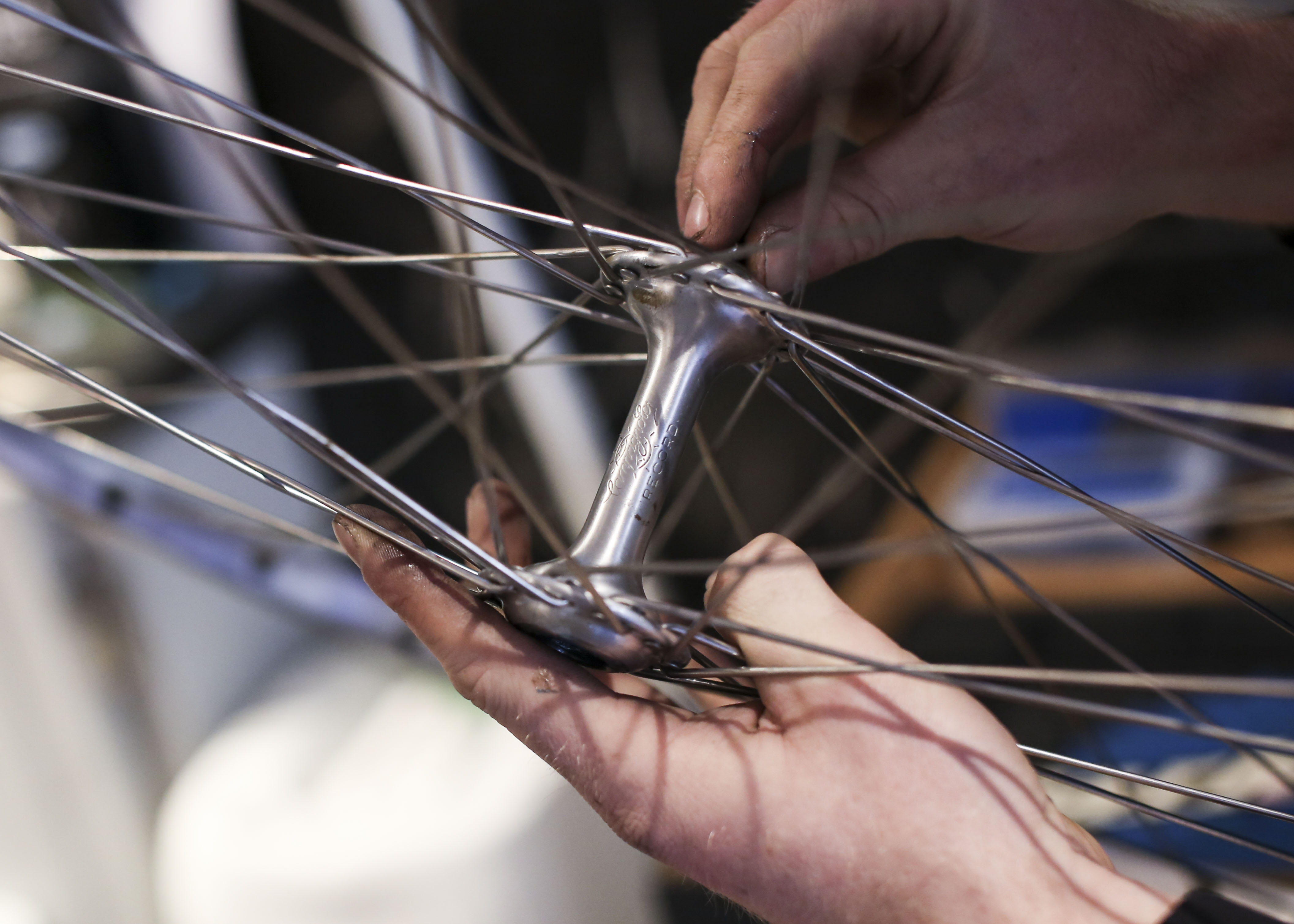 One of our mechanics examines a wheel.
