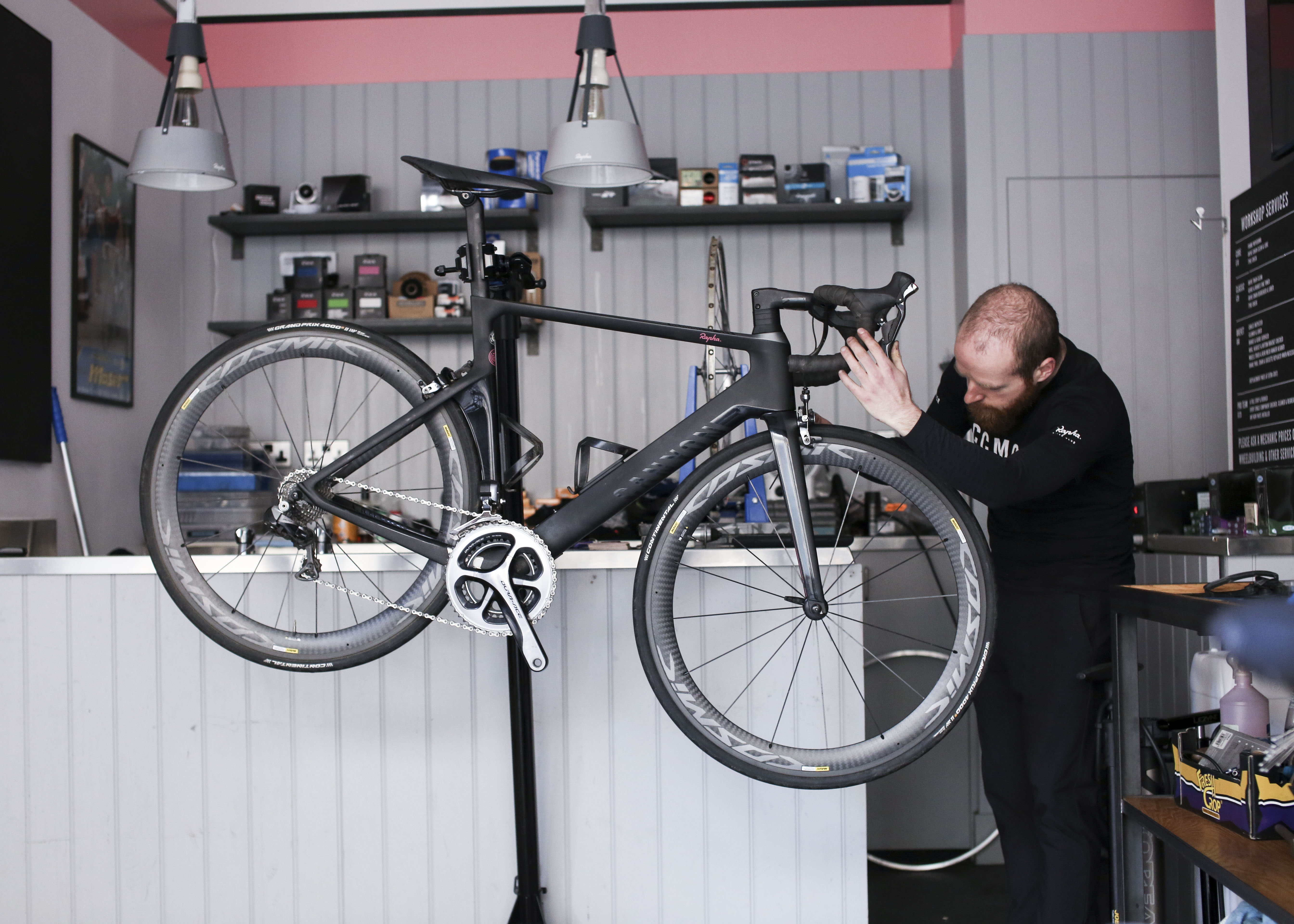 One of our mechanics working in the Rapha Manchester Workshop.